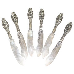 "Six Sterling Silver Figural ""Labors of Cupid"" Knives by Dominick & Haff"