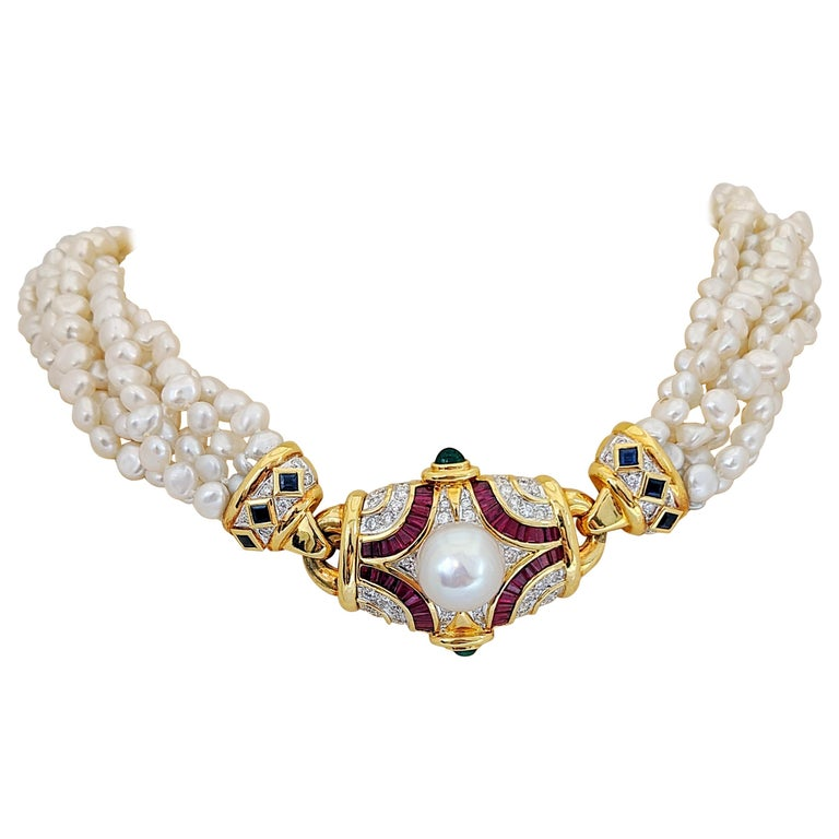 Six Strand Pearl Necklace with Diamond, Ruby, Emerald, and Blue Sapphire Center For Sale