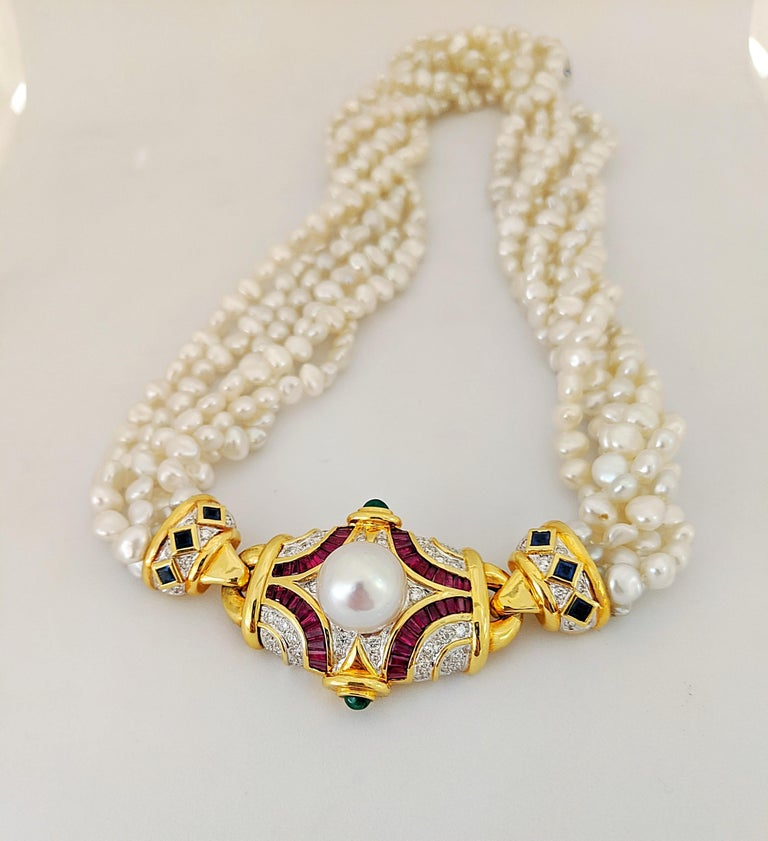 Retro Six Strand Pearl Necklace with Diamond, Ruby, Emerald, and Blue Sapphire Center For Sale
