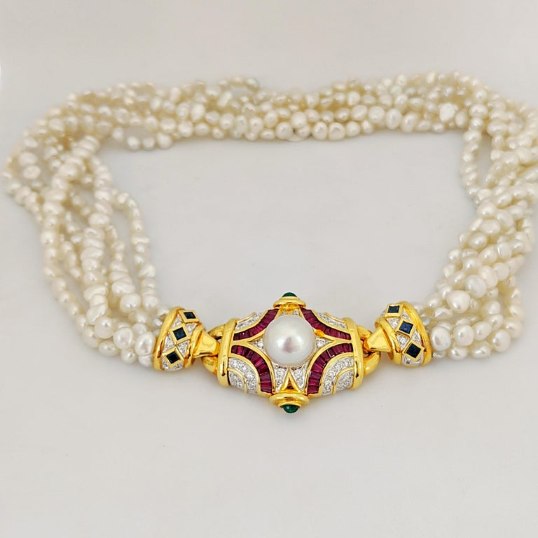 Round Cut Six Strand Pearl Necklace with Diamond, Ruby, Emerald, and Blue Sapphire Center For Sale