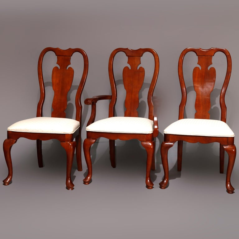 A vintage set of 6 dining chairs by Universal Furniture in the manner of Pennsylvania House offer cherry construction in Queen Anne styling with backs having shaped rail and stylized urn slat backs over upholstered seats raised on cabriole legs with
