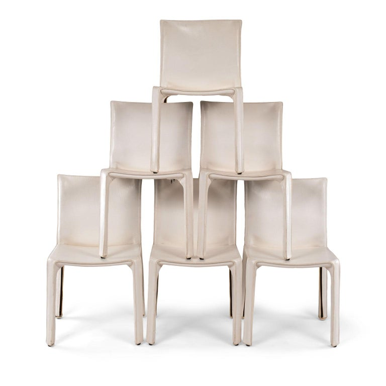 Six white Mario Bellini cab 412 side chairs, fabricated by Cassina in the 1980s. Flexible steel frame covered with a skin of high quality white saddle leather. This elegant, versatile chair is equally suitable for the dining room, study or living
