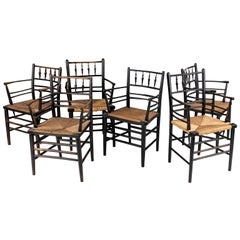 Six William Morris Ebonized Sussex Armchairs
