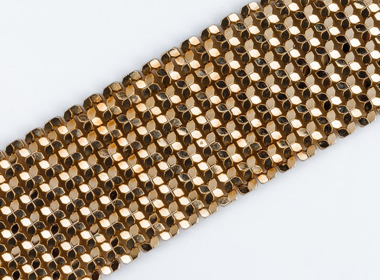 Magnificent Italian mesh bracelet in a solid jointed grid of yellow gold, from 1960s, with lines of small multifaced pieces. Double safety lock Contrast from Vicenza 3VI-FOB-750     MATERIAL ◘ Weight 95 grams  ◘ Size 19x5,1 cm  / 7.4x2 inches