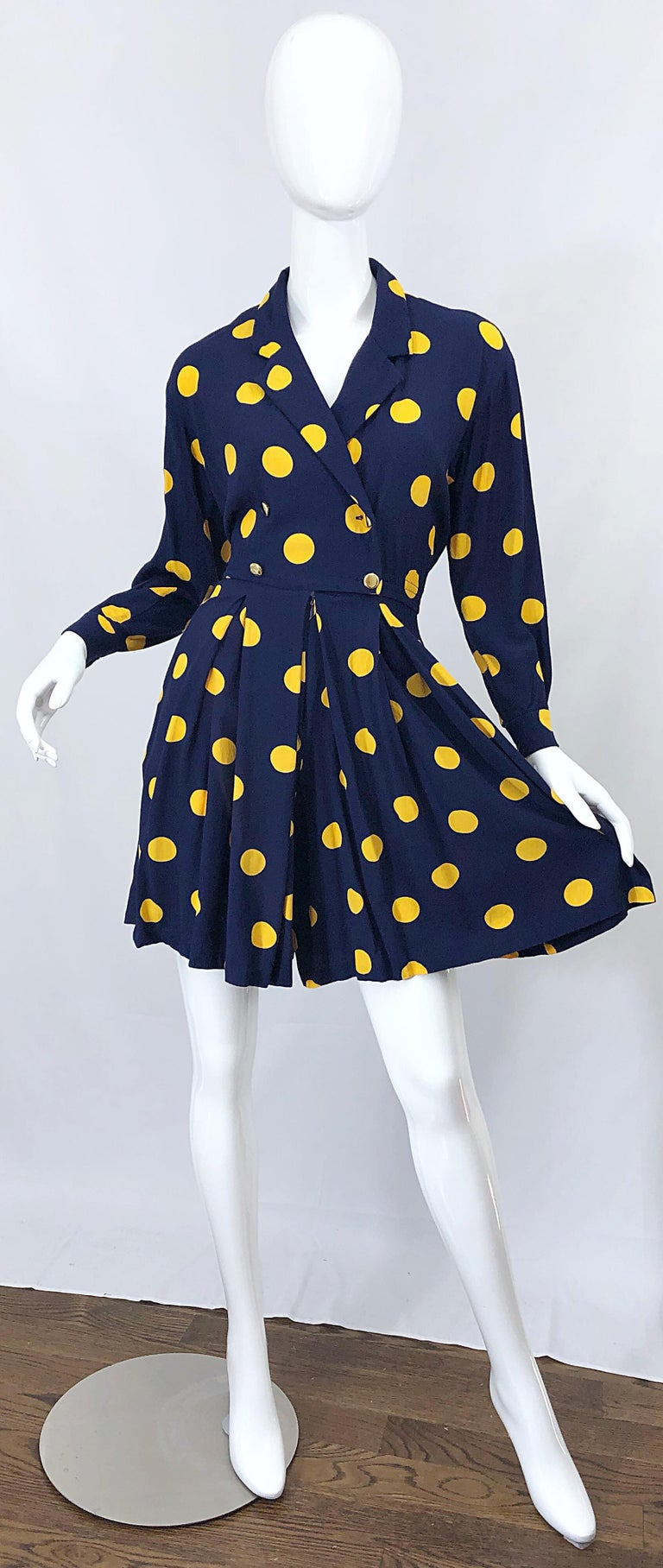 Chic late 80s LIZ CLAIBORNE long sleeve navy blue and marigold yellow polka dot one piece romper! Features a fitted bodice, with forgiving wide legs. Double breasted fit, with gold buttons on the front and at each sleeve cuff. POCKETS at each side