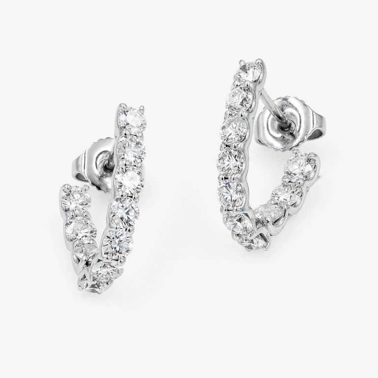 These custom crafted Lester Lampert original SkaLLop™ J-Hoop earrings are set in 18kt. white gold with 20 ideal cut round diamonds= 2.02cts. t.w. (the diamonds are G in color and VS in clarity)  Every Lester Lampert piece will arrive in an elegant