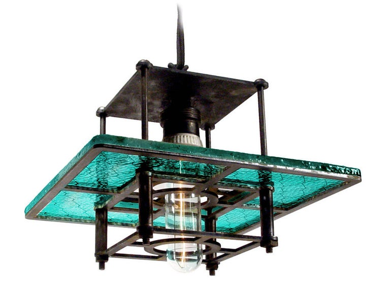 This is one of the first lamps The Early Electrics Design Studio introduced and featured a rare blue green Industrial glass. It quickly sold out. It took a couple of years to discover another collection of this hard to find color glass and can offer