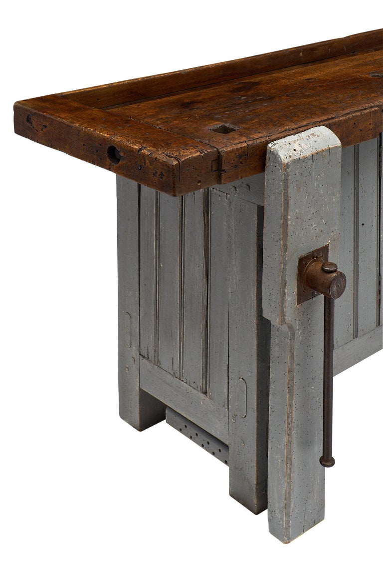 """French antique """"ski crafting"""" workbench from the French Alps. We fell in love with this rare ski crafting carpenter workbench made of fir. We couldn't resist the original painted color, iron vise, and dramatic decorative impact of the piece. There"""