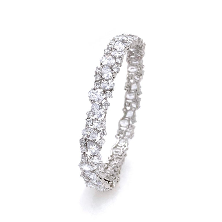 Fabulous Skinny All-around Encrusted Faux Diamond Sterling Silver Bracelet. This bracelet features over 100 pcs of various shape of faux diamond cubic zirconia (AAA quality), handset on platinum rhodium plated sterling silver.  Push clasp closure