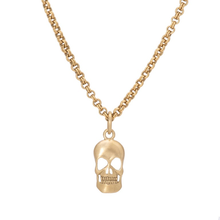 Our Skull Pendant in 18 karat gold is hand crafted in our studio with our signature satin finish offering a lustrous take on a classic. The curved form of our skull pendant reveals a 3 dimensional perspective with a stippled finish in the back. At