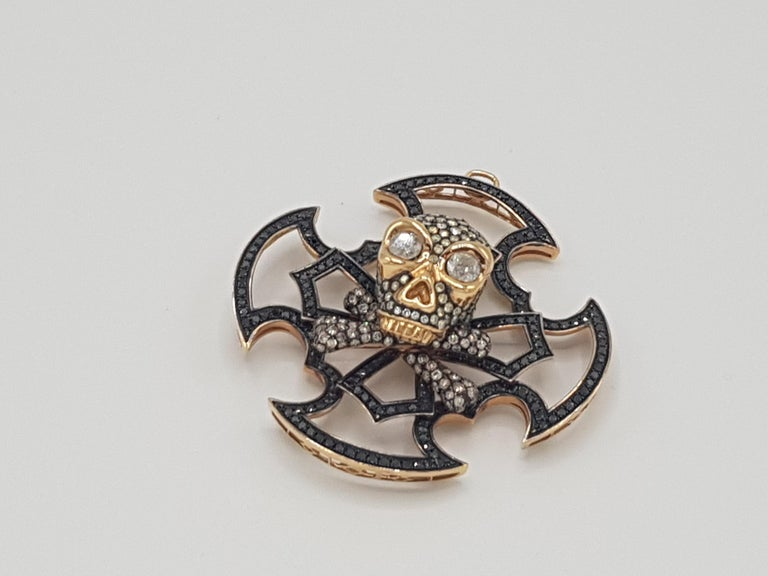 d'Avossa Skull Pendant, in 18 kt yellow and black gold, this stylish pendant is made with 11,10 cts Ice and Black Diamonds   Unique Piece