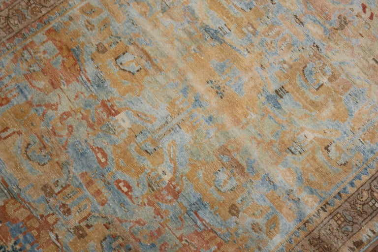 Lovely Persian throw scatter size rug with a sky blue field, the main accent color is in peach,  circa 1940. Measures: 3'5