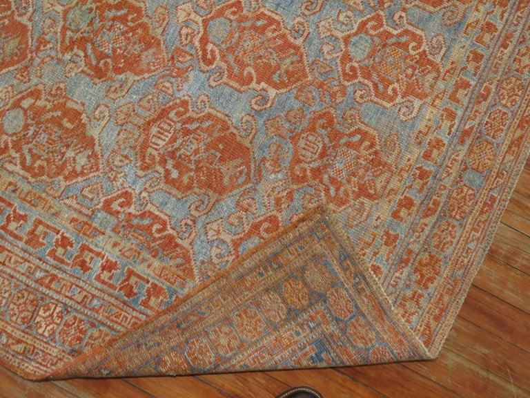 An early 20th century Persian Afshar Tribal rug in sky blue and terracotta tones, circa 1930.  Measure: 4'4'' x 4'10''.