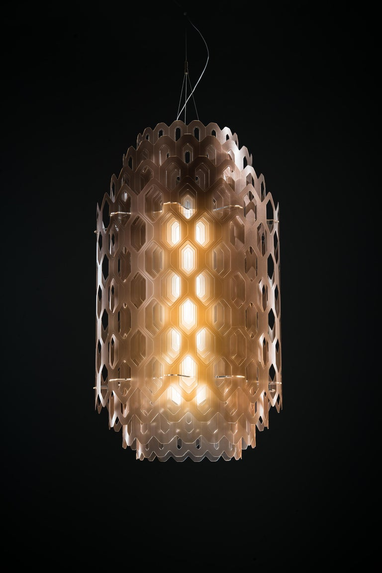 Chantal's sculptural shape seems to be molded from a singular, industrious frame, much like honeycomb with its impalpable elements. Its concentric, hexagonal shapes allow for unending views. Chatal's LED source resembles waves pulling away from the