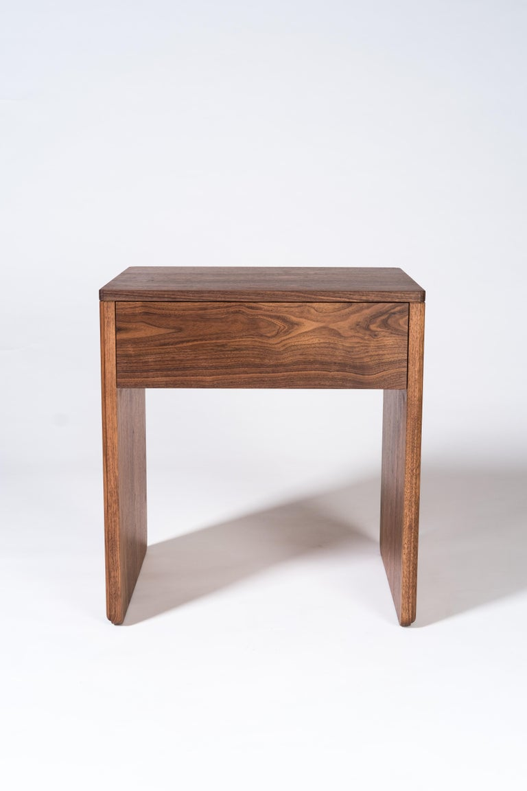 The Slate series of tables is characterized by a simple solid silhouette with subtle detailing and storage. The side table works well in the living room along with the matching coffee and console while also making a great bedside or nightstand. The