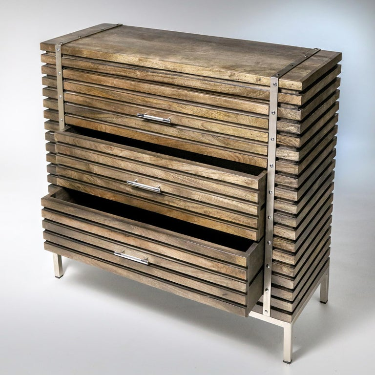 Sleek, modern 3-drawer chest in horizontal mahogany slats with polished steel legs, straps, and hardware.