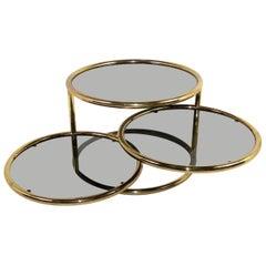 Sleek Milo Baughman Style Brass and Glass Swiveling Coffee Table