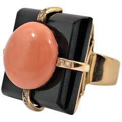 Sleek Onyx Angel Skin Coral Gold and Diamond Ring