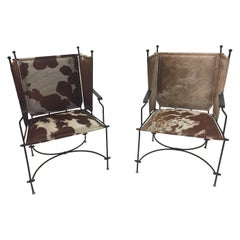 Sleek Pair of Wrought Iron Cowhide and Leather Mid-Century Modern Club Chairs