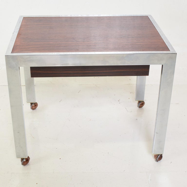 Scandinavian Danish modern sleek rectangular side table rosewood & chrome on rolling casters Single recessed rosewood drawer. Denmark circa 1960s. Unmarked. Reminiscent of Milo Baughman design. Dimensions: 20 x 15 x 16.75 H, Drawer 2.25 H x 13.5 D