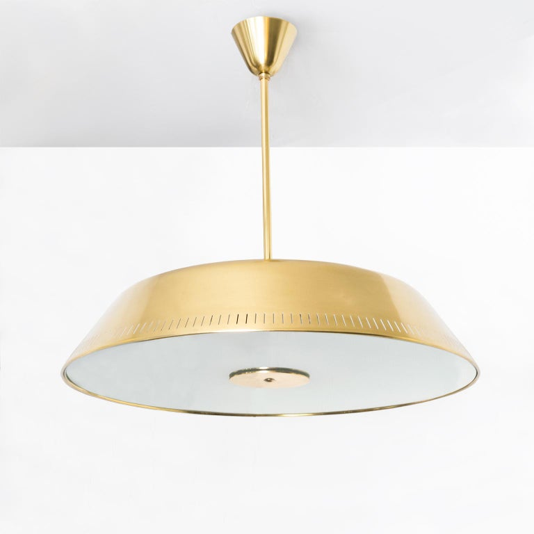 Sleek Scandinavian Modern polished brass and glass pendant designed by Harald Notini made by Böhlmarks, Sweden. This fixture has been completely restored, (polished and lacquered) and newly rewired for us in the USA with 6 internal standard base