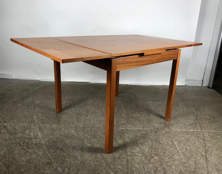 Scandinavian Modern Sleek, Simple Expandable Teak Dining Table Made in Denmark For Sale