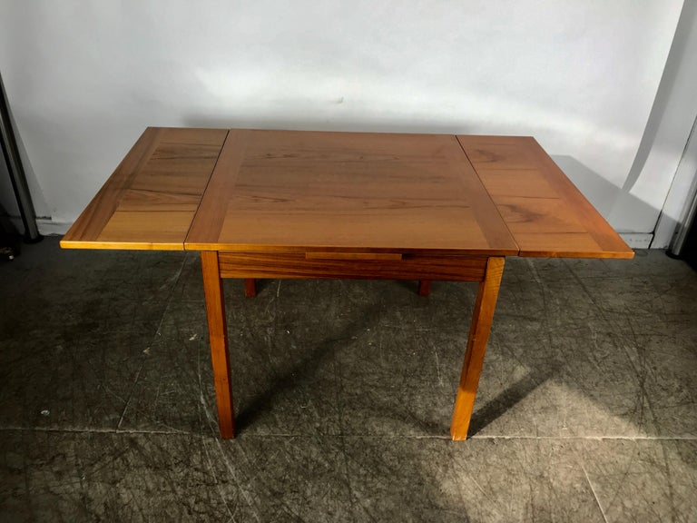 Mid-20th Century Sleek, Simple Expandable Teak Dining Table Made in Denmark For Sale