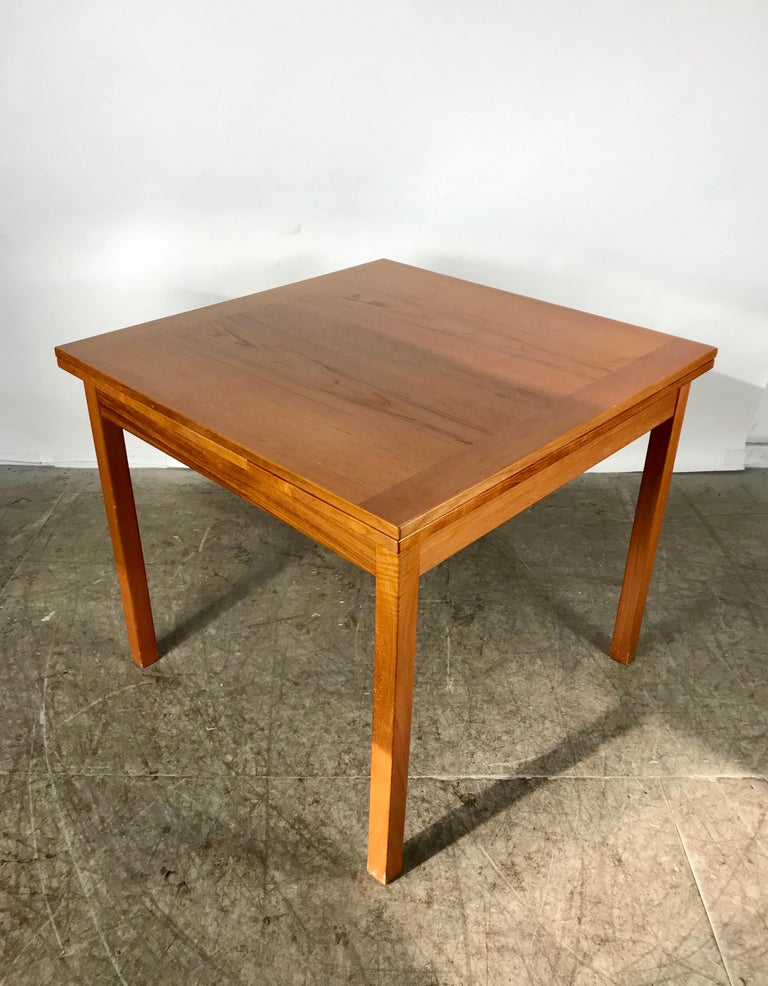 Sleek, Simple Expandable Teak Dining Table Made in Denmark For Sale 1