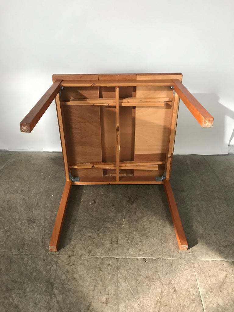 Sleek, Simple Expandable Teak Dining Table Made in Denmark For Sale 3