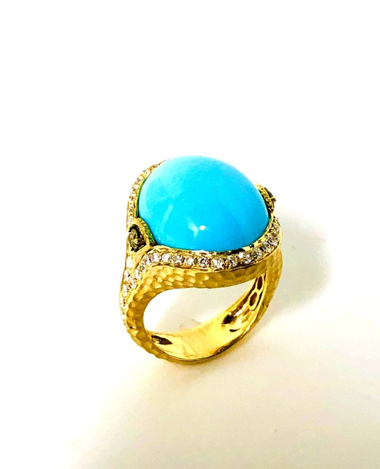 This stunning ring features a huge and absolutely gorgeous oval turquoise cabochon from the renowned Sleeping Beauty Mine in Arizona. Although famous as the site of some of the most beautiful