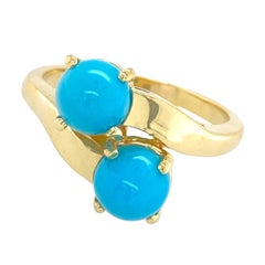Sleeping Beauty Turquoise Bullet Cabochon Bypass Ring in 18 Karat Yellow Gold