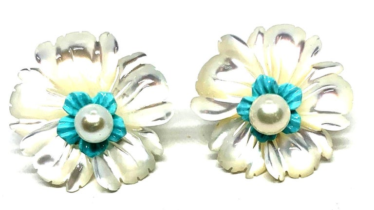 Interchangeable flower earring jackets are finely hand carved in mother-of-pearl, turquoise, and rock crystal quartz. Pearl posts are worn at the center of these earring jackets adding a lovely touch to these beautiful floral earrings. Just right