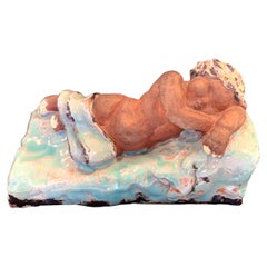Sleeping Child Bookends, Probably Viennese, with Pale Blue and Yellow Glazes