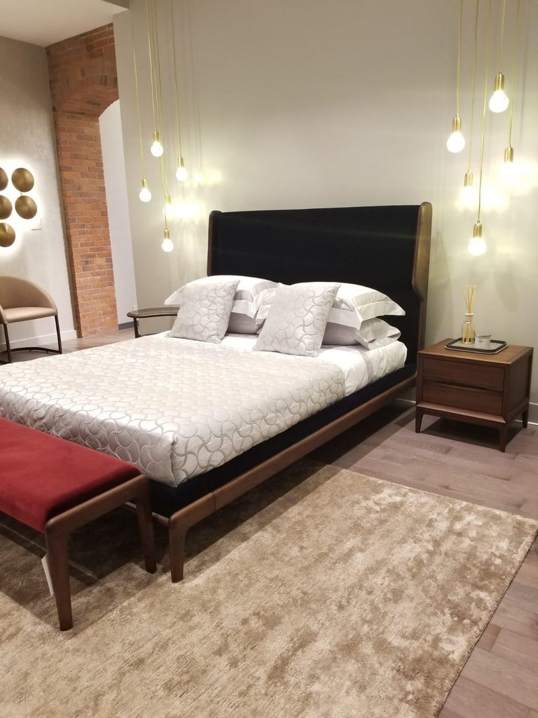 This product is currently on showroom display.   Ceccotti Collezioni sleeping muse designed by Roberto Lazzeroni  Queen size bed made in dark solid American walnut, bed base in veneered plywood, upholstered headboard and bed fascia, covered in navy