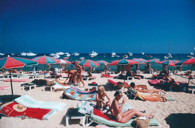 Beach at St. Tropez (Slim Aarons, 20th Century, Sunbathing, Portrait, Nude) - Photograph by Slim Aarons