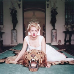 Beauty and the Beast - Slim Aarons, 20th Century, Tiger rug, Red lipstick, Blond