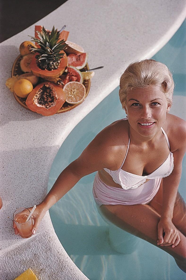 Coconut Cocktail - Slim Aarons, 20th Century photograph, Bikini, Nude, Blonde