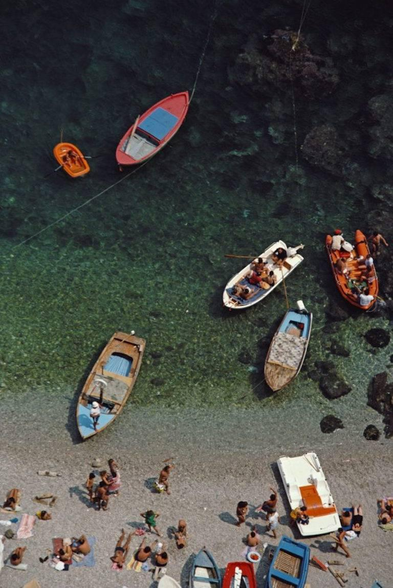 'Conca dei Marini' by Slim Aarons   Limited Estate Edition - numbered to 150 in ink on front and emboss stamped.  A bay in Conca dei Marini, on the Amalfi coast in Italy, August 1984.   In his words, he photographed 'beautiful people in beautiful