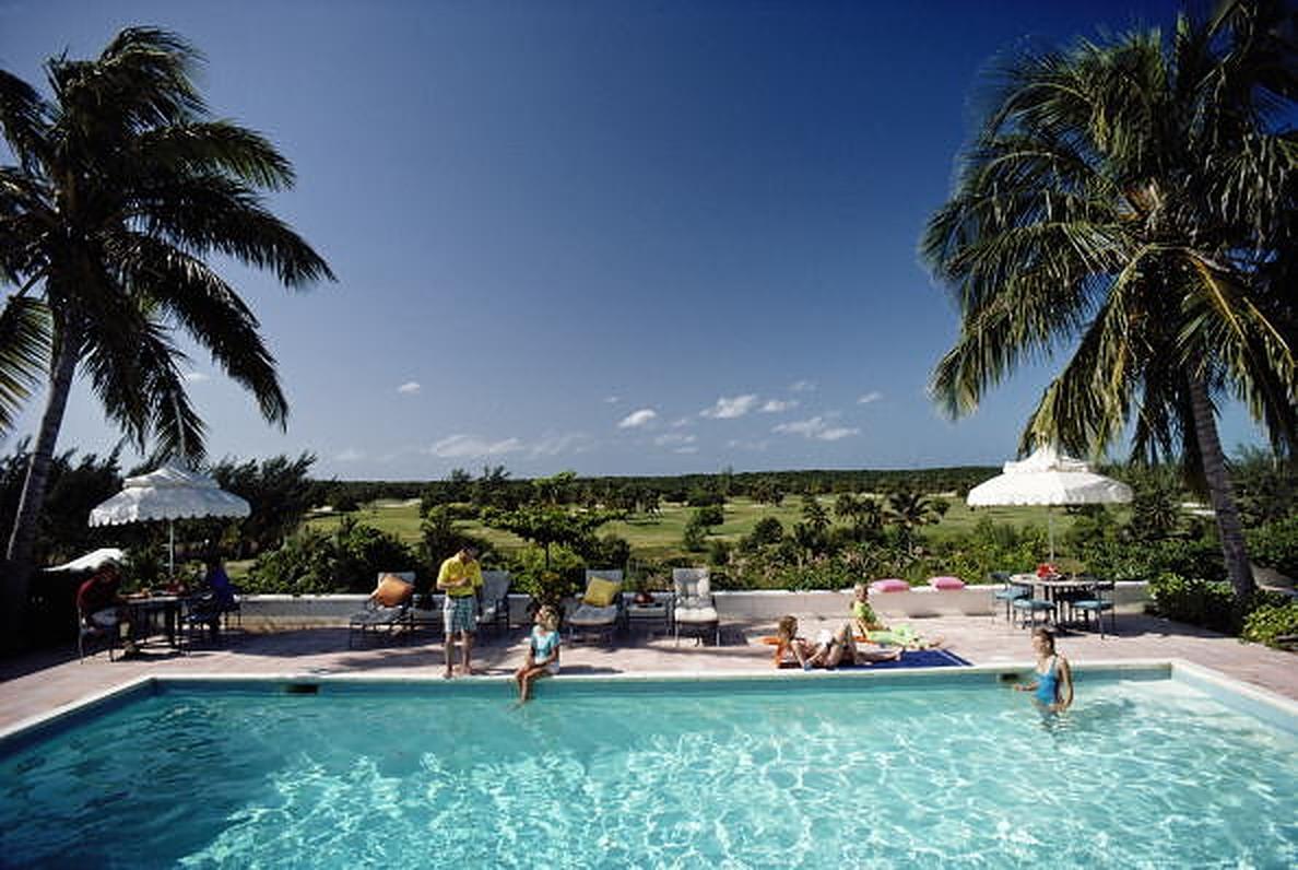 Cotton Bay, Bahamas - Slim Aarons, 20th century photography, Poolside, Palm tree