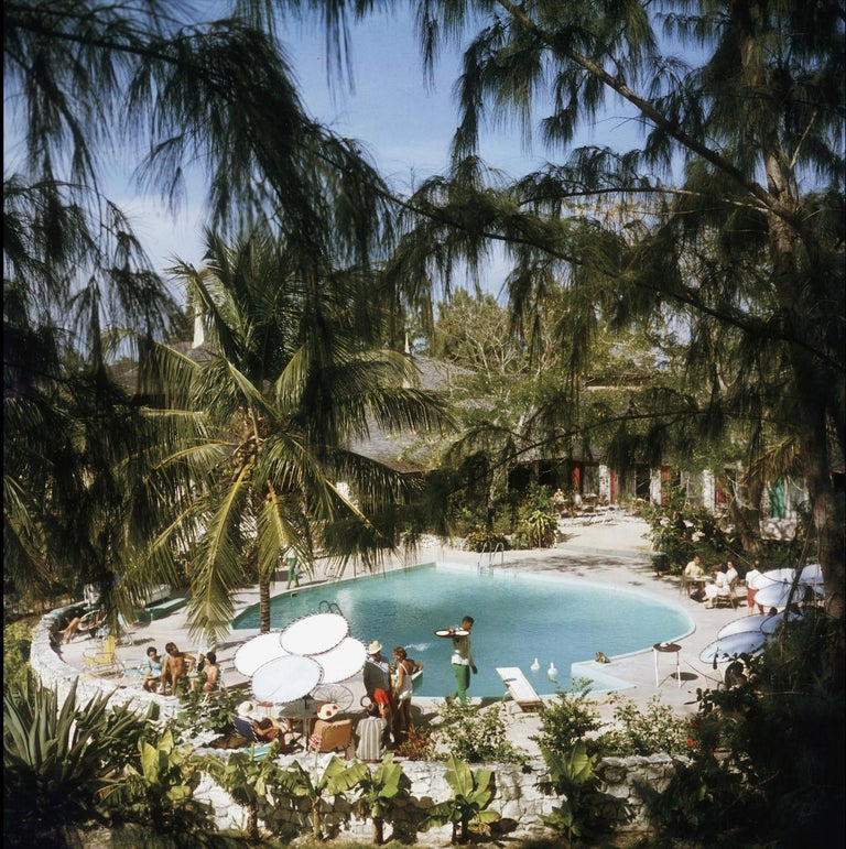 Eleuthera Pool Party -  Slim Aarons - Bahamas - color photography 20th century - Photograph by Slim Aarons