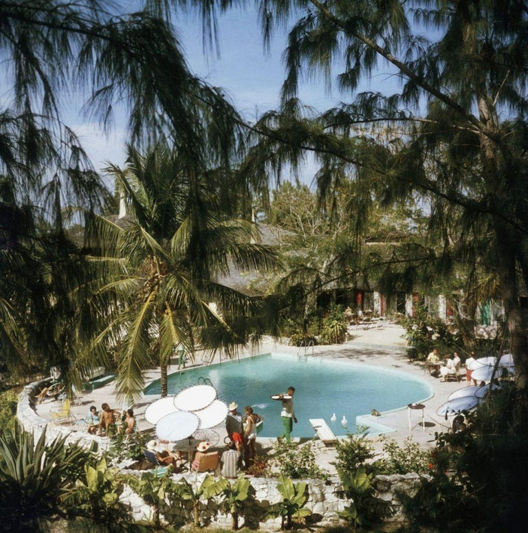 'Eleuthera Pool Party' (Slim Aarons Estate Edition) - Photograph by Slim Aarons