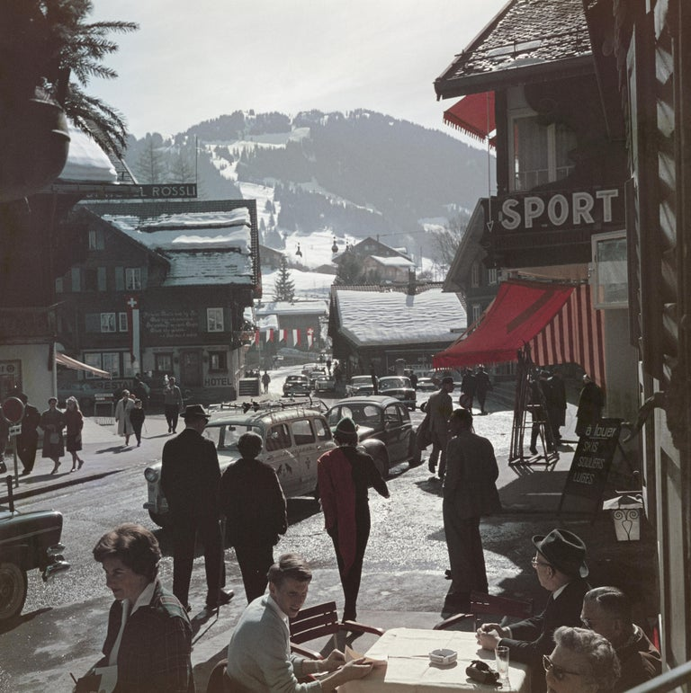 The town centre at the ski resort of Gstaad, Switzerland, 1961.   Once a year, we uncover never-before-seen Slim Aarons images! This is one of fifteen from our new collection. A word from our Curator Shawn Waldron:  'For the 2019 edition – our third