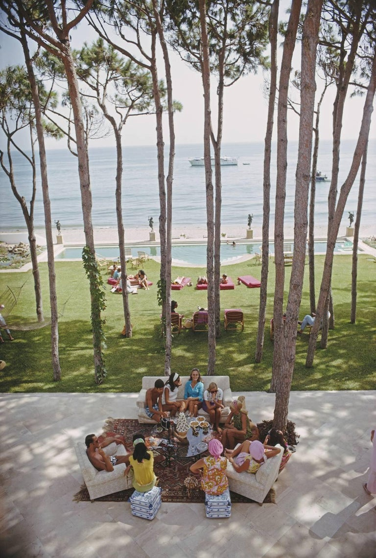 'Marbella House Party' 1980 Italy by Slim Aarons  Guests at a party at the home of Sebastiano Bergese in Marbella, Spain, August 1967.  (Photo by Slim Aarons)   Oversize 60x40 inches paper size certified Slim Aarons Estate Stamped C Type