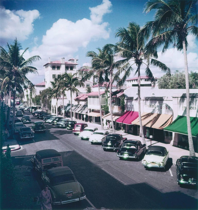 Palm Beach Street (Slim Aarons Estate) - Photograph by Slim Aarons