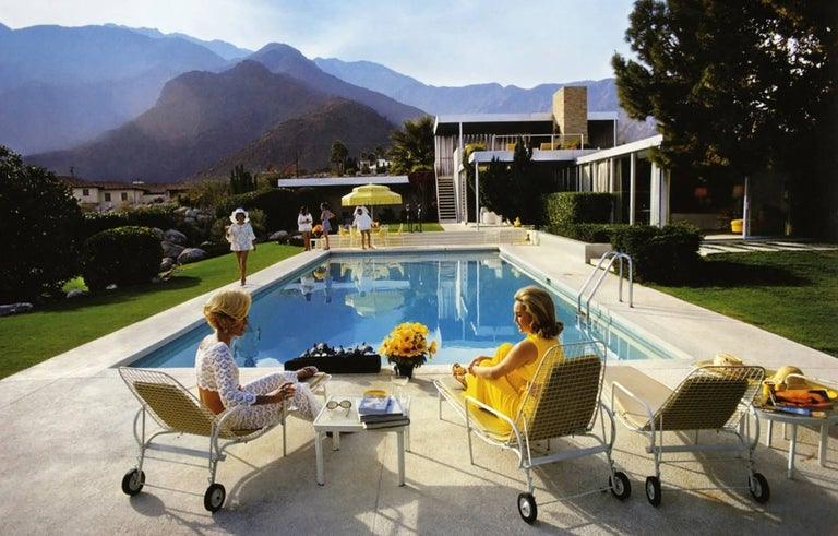 A desert house in Palm Springs designed by Richard Neutra for Edgar Kaufman. Lita Baron approaches Nelda Linsk, right, wife of art dealer Joseph Linsk who is talking to a friend, Helen Dzo Dzo. A variation of his sold out photo Poolside Gossip.