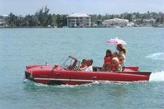 Sea Drive - Slim Aarons, 20th Century, Red cars, Sea, Ocean, Water, Parasol