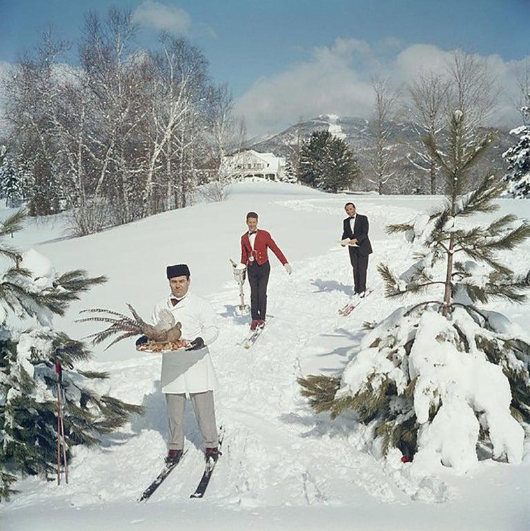 Skiing Waiters, (Slim Aarons Estate Edition) - Photograph by Slim Aarons