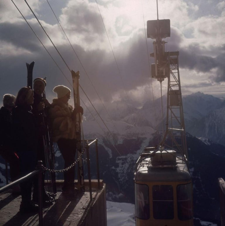 Limited Edition Estate Stamped Print (edition size 1/150). Skiers waiting for the cable car at Verbier in Switzerland, 1964. (Photo by Slim Aarons)  This photograph epitomises the travel style and glamour of the period's wealthy and famous,
