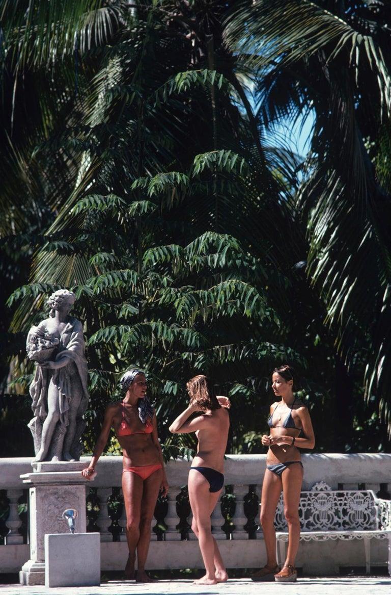 Slim Aarons Estate Edition - BIKINIS IN HAITI - Photograph by Slim Aarons