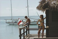 Slim Aarons Estate Edition -  Fishing On Honeymoon Porch